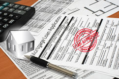 Application for a mortgage loan is on the table Royalty Free Stock Images