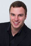 Application photo of a young man. Who is smiling Stock Photography