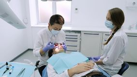 Application of protective whitening gel to the teeth. stock footage