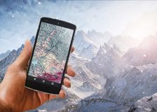 Application of satellite navigation on your phone to find a route concept travels. Application of satellite navigation on your phone to search for the route and royalty free stock photography