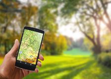 Application of satellite navigation on your phone to find a route concept travels. Application of satellite navigation on your phone to search for the route and stock photos