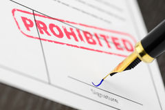 Application signed, fountain pen and stamp prohibited, close up shot. Royalty Free Stock Photography