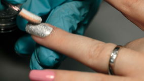 Application Silver gloss to the nail stock footage