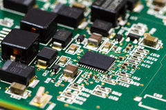 Application Specific Integrated Circuit. ICs, chip capacitors, and chip resistors mounted on a Printed Wiring Board Royalty Free Stock Photos
