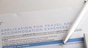 Application for travel and accommodation expenses with pen. On the table stock images