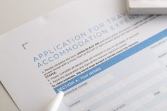 Application travel form with pen. Wait to full fill data royalty free stock image