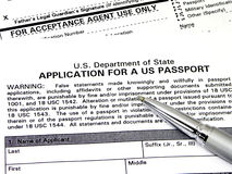 Application For A U.S. Passport. With pen placed on top. Front page is laying on page two (agency use only portion) of the DS-11 form Stock Photography