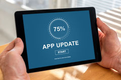 Application update concept on a tablet. Male hands holding a tablet with application update concept stock photography