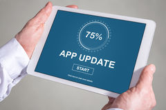 Application update concept on a tablet Stock Images