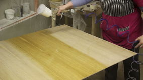 The Application Of Varnish On A Wooden Surface. Application Of Varnish On A Wooden Surface stock footage