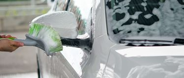 Application of a white foam for cleaning the car and windows royalty free stock image