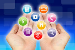 Applications on hands. Business applications on two hands stock photo