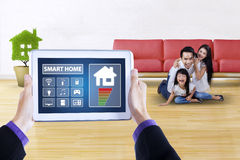 Applications of smart house with cheerful family Royalty Free Stock Photography