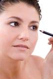 Applicazione del eyeliner immagine stock libera da diritti