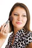 applicera härligt makeupkvinnabarn Arkivfoto