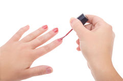 applicera manicuren spika den polerade röda kvinnan Arkivbilder