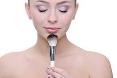 applicera smink Fotografering för Bildbyråer