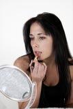 applicera sminkkvinnan Arkivbilder