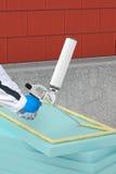 Applicera termisk isolering med skumvapnet på fasad Arkivfoton