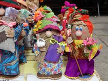 Applied art rag dolls are made in Ukrainian traditions. In bright costumes Royalty Free Stock Image
