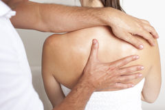 Applied chiropractic care on spine Royalty Free Stock Images