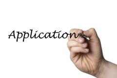 Applikation som är skriftlig vid en hand Royaltyfria Foton