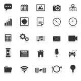 Applikationsymboler med reflekterar på vit bakgrund Arkivbild