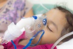 Appling aerosols inhalation. My daughter is curing lung with aerosols inhalation stock photography