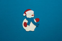 Applique de papel del muñeco de nieve en fondo de la textura Fotografía de archivo