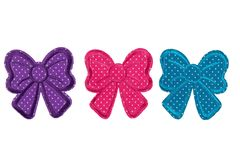 Applique from the fabric of three colored ribbons. Isolate. On white background Stock Photos