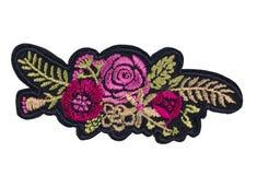Applique sur le tissu, fleurs isolat images stock