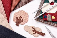 Applique tools for fabric and detail of applique Stock Photos
