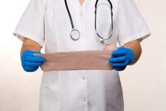 Apply bandage. Medical nurse applying a bandage royalty free stock photography