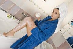 Apply body cream royalty free stock photography