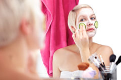Apply cucumber face mask Stock Image