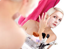 Apply face cream Royalty Free Stock Image