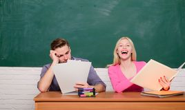 Apply for free program. Couple friends students studying university. Guy and girl sit at desk in classroom. Correct. Answer on their mind. Enjoying university royalty free stock images
