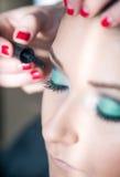 Apply makeup Royalty Free Stock Photo