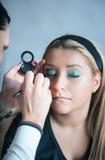 Apply makeup Stock Photography