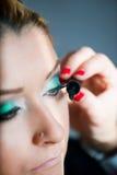 Apply makeup Stock Photos