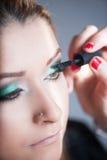 Apply makeup Stock Photo