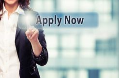 Apply Now. Business woman pressing Apply Now button at her office stock images