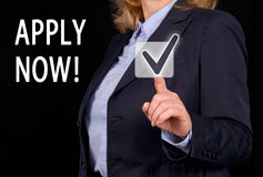 Apply now  - Businesswoman with checkbox and text Stock Photo