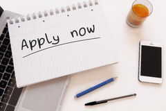 Apply now. Handwritten text in a notebook on a desk - 3d render illustration Stock Photo
