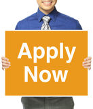 Apply Now!. A man in office attire inviting applicants Royalty Free Stock Photography