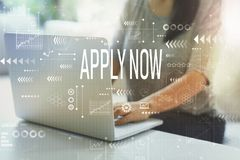 Apply now with woman. Using her laptop in her home office stock images