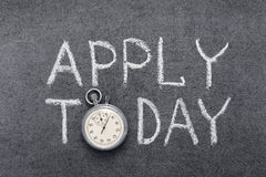 Apply today. Phrase handwritten on chalkboard with vintage precise stopwatch used instead of O stock images