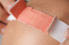 Applying adhesive bandage Royalty Free Stock Photos