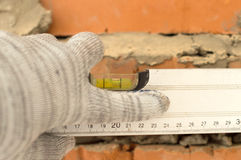 Applying aluminum, the water level of the brick wall Stock Photo