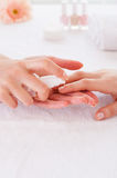 Applying antiseptic on nails. Stock Photo